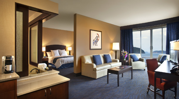 Suite includes living area with sofa, armchairs and work area plus a king-sized bed